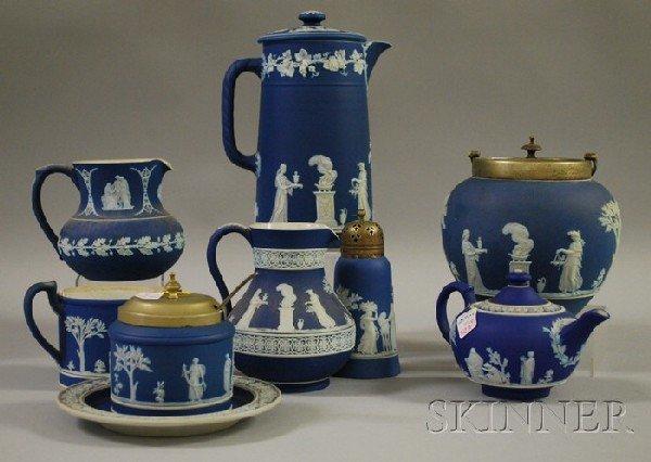 523: Nine Wedgwood Dark Blue Jasper Dip Items, a jar, t