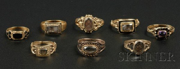 700: Eight Gold Mourning Rings, 19th century, six 14kt