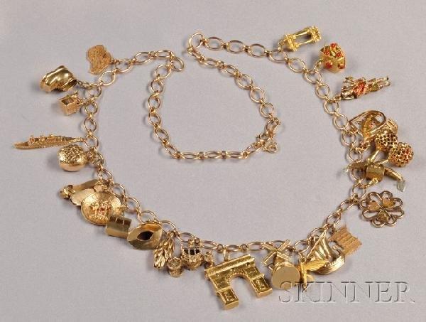 6: Travel Charm Necklace, comprising twenty-four 18kt,