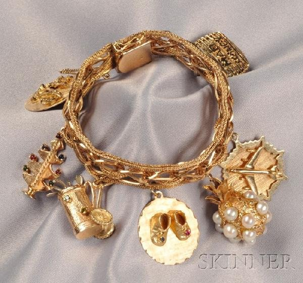 8: 14kt Gold Charm Bracelet, the seven charms including