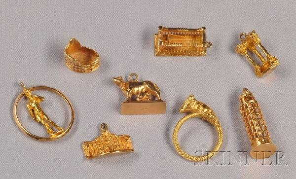 9: Group of 18kt Gold Tourist Charms, including the Par