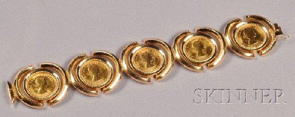 12: 18kt Gold and Gold Sovereign Bracelet, bezel-set wi