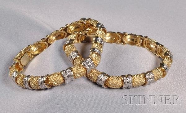 16: Pair of 14kt Bicolor Gold and Diamond Bracelets, of