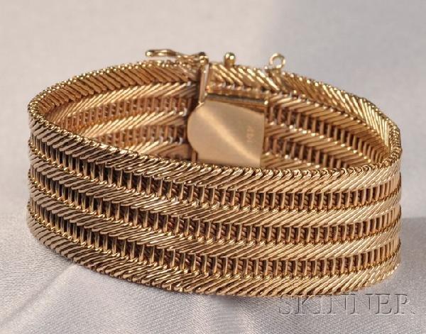 24: 14kt Gold Bracelet, designed as a strap of woven ba