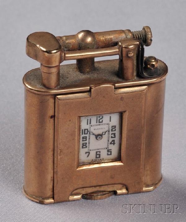 506: 9kt Gold Lighter, Dunhill, Switzerland, set with a