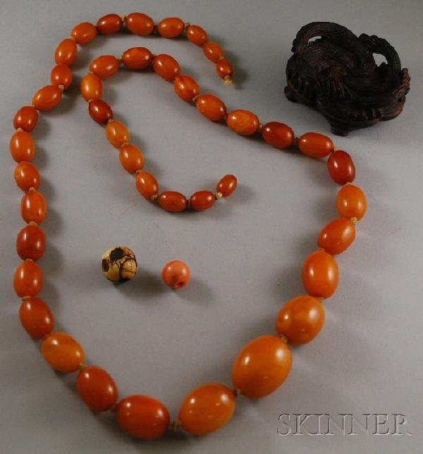 213: Butterscotch Amber Necklace, together with a carve