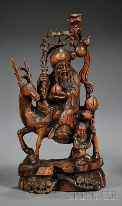 864: Wood Carving, China, carved as Shoulao riding on a
