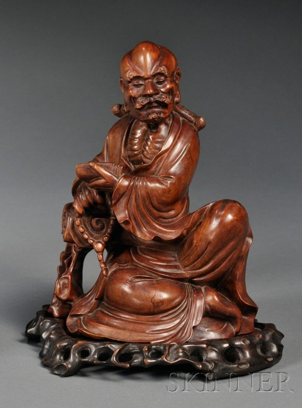 866: Rosewood Carving, China, carved as seated figure o