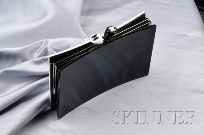 10: Lucite Clutch, Chanel, of black and white concave L