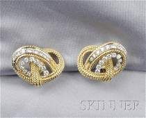357 18kt Gold and Diamond Earclips each designed as a
