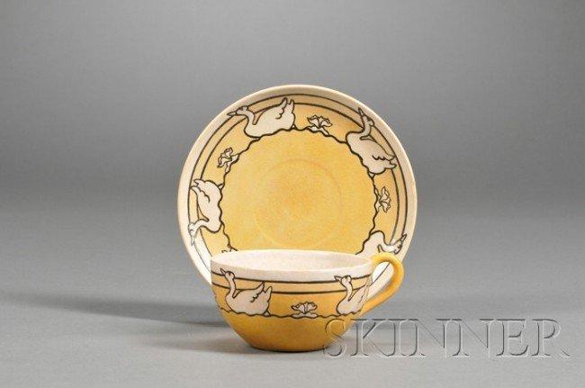 23: Saturday Evening Girls Pottery Teacup and Saucer De