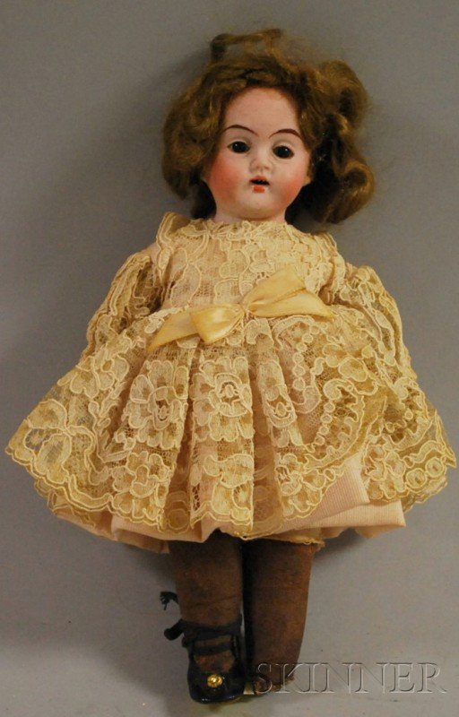 1012: Small Character Bisque Shoulder Head Doll, fixed