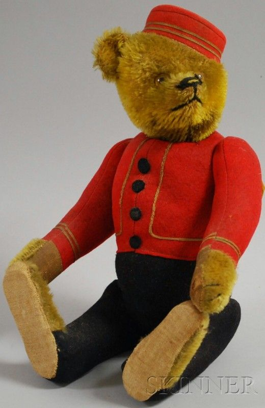1121A: Schuco Yes/No Bellhop Teddy Bear, in uniform, ta