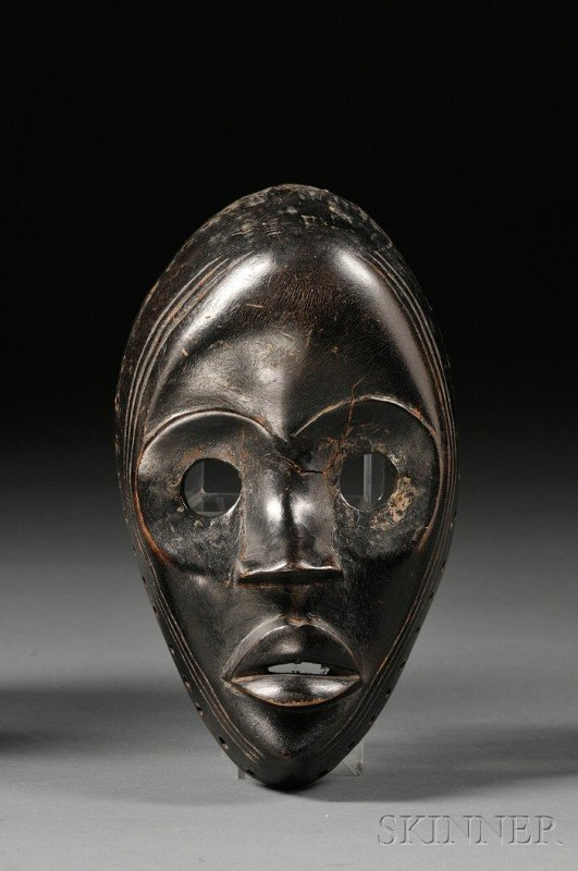 199: African Carved Wood Mask, Dan, the hollow oval for