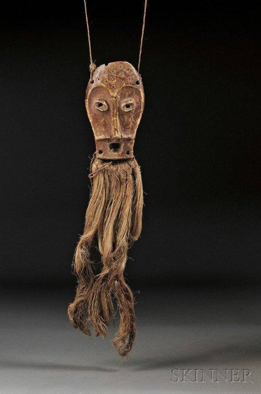 203: African Carved Ivory Masquette, Lega, the stylized