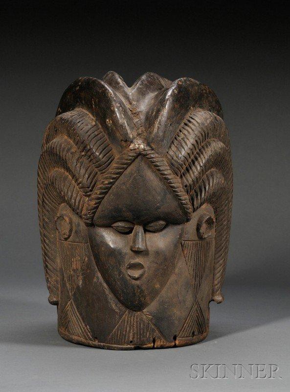 209: Bassa Bundu Carved Wood Helmet Mask, the face with