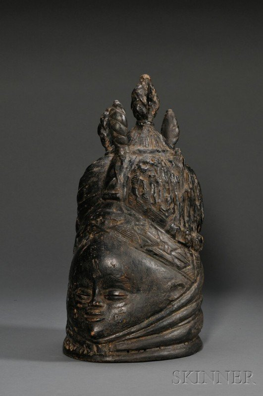 214: Mende Bundu Carved Wood Helmet Mask, with rolls of