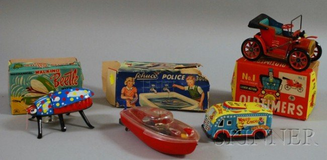 13: Four Tin and Plastic Toy Vehicles, mid-20th century