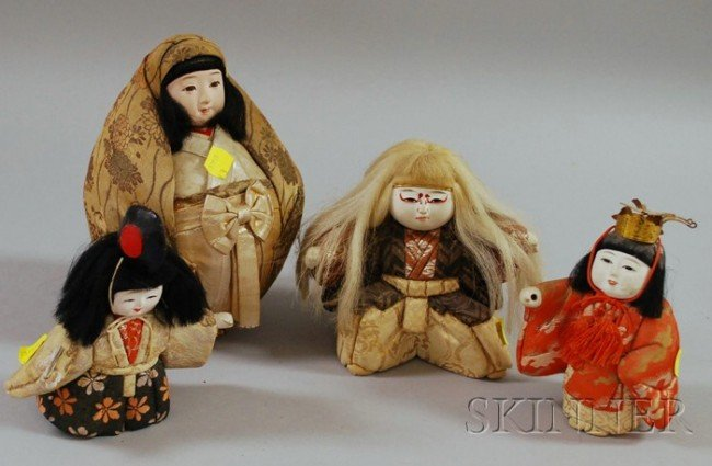 16: Four Japanese Female Dolls, all labeled or stamped