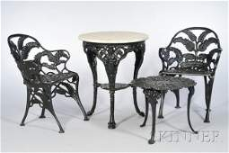 915: Eight Pieces of Black-painted Cast Iron Garden Fur