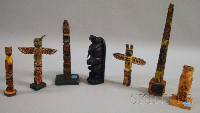 516: Seven Wooden Painted Tourist Totem Poles, ht. to 1