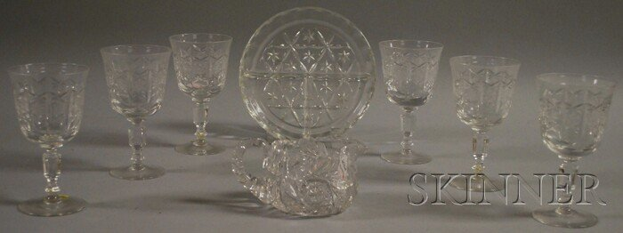 506: Eight Glass Table Items, six footed water glasses,