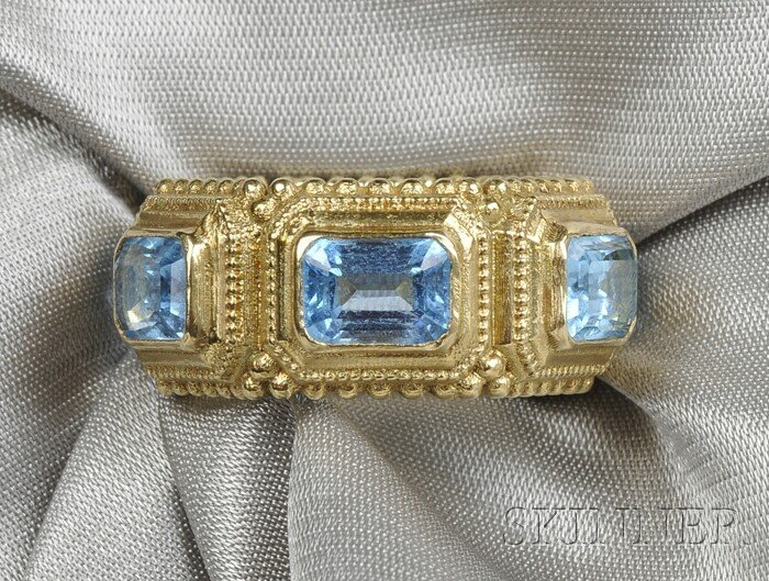 6: 18kt Gold and Blue Topaz Ring, bezel-set with six em