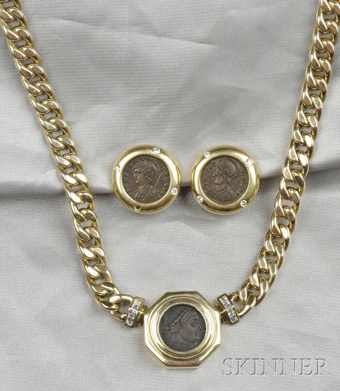 8: 14kt Gold Suite, the necklace bezel-set with an anci