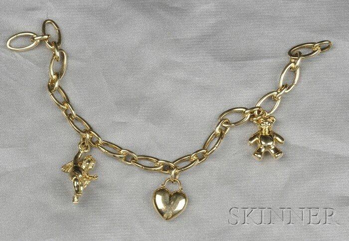12: 18kt Gold Charm Bracelet, Tiffany & Co., composed o