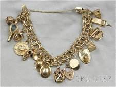 304 Gold Charm Bracelet composed of fifteen 9kt 10kt