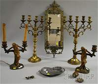 1057 Six Decorative Metal Items a pair of brass cande