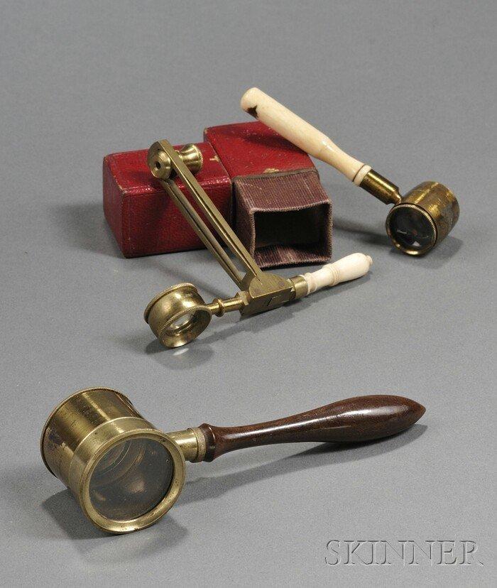 12: Three Handheld Microscopes, 19th century, an ivory-
