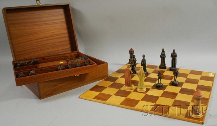 717B: Cased Painted Figural Chess Set with Wood Parquet