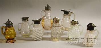 1098: Eight Victorian Art Glass Syrups, two colorless p