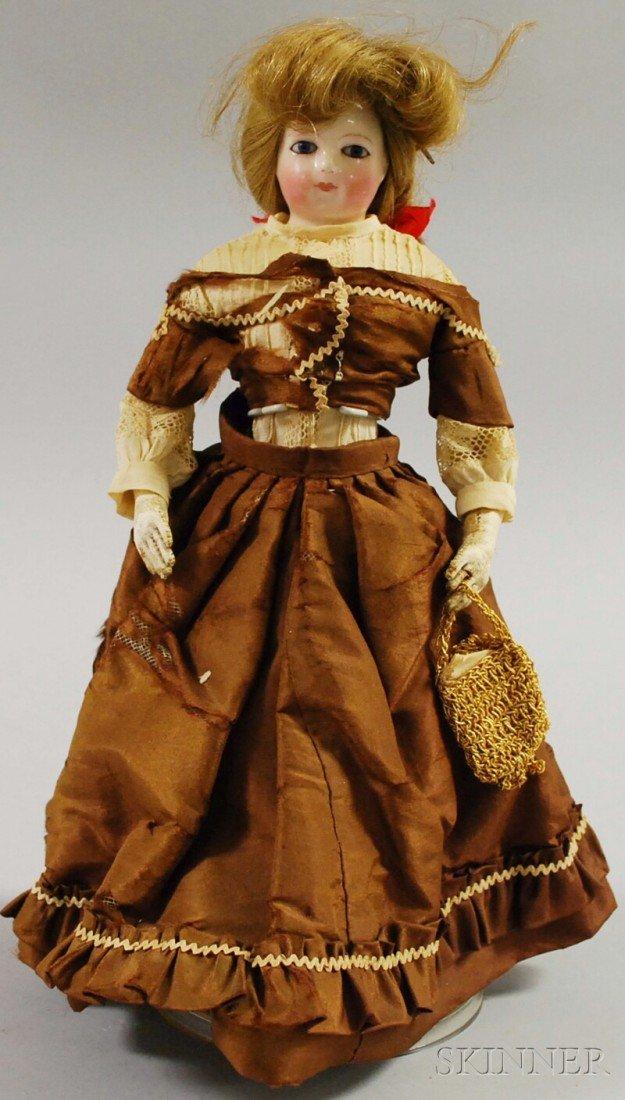 20: China Shoulderhead Doll, 1860s, kid body, ht. 10 1/