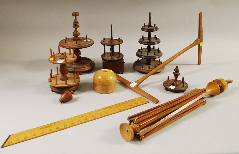 719: Eight Wooden Sewing Items, a swift, winder, ruler,