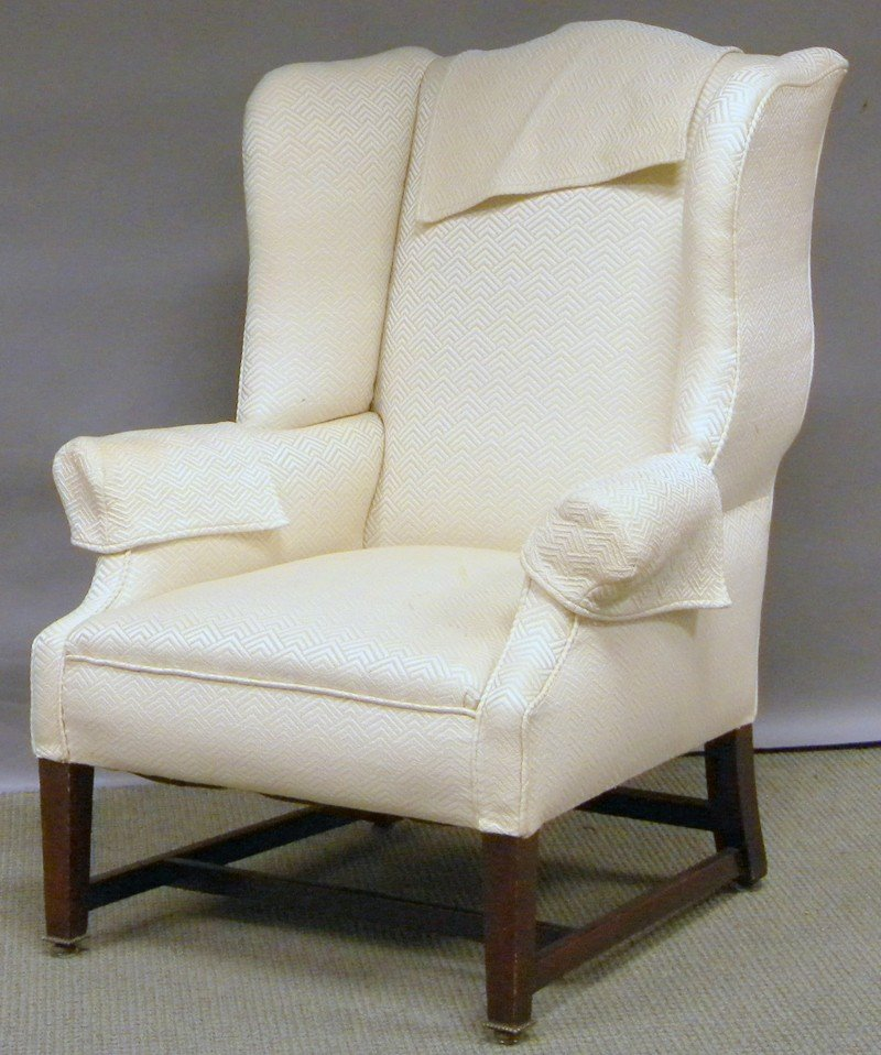 514: Chippendale Upholstered Walnut Wing Chair.