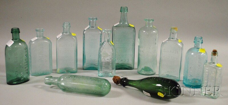 1077: Twelve Aqua and Colored Molded Glass Bottles, inc