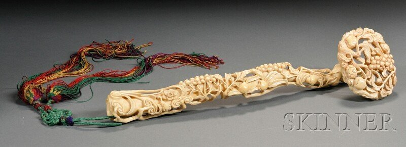 279: Ivory Ruyi, China, carved with scrolling peach bra