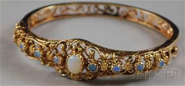 270: 14kt Gold and Opal Bangle Bracelet, total 15.9 dwt