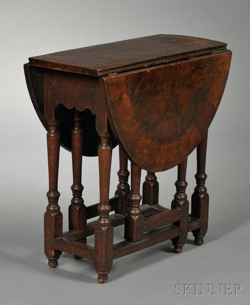 7: William & Mary-style Oyster-veneered Gate-leg Table,