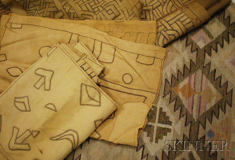 502: Three Kuba Cloths and a Peruvian Textile.