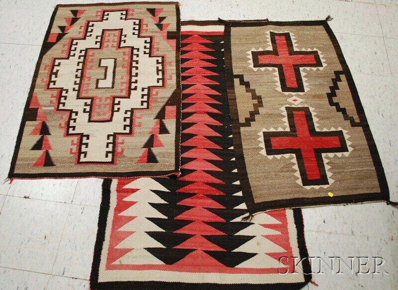 519: Three Navajo Rugs, various patterns.