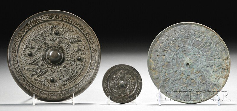 20: Three Bronze Mirrors, one Chinese, Han period, (2nd