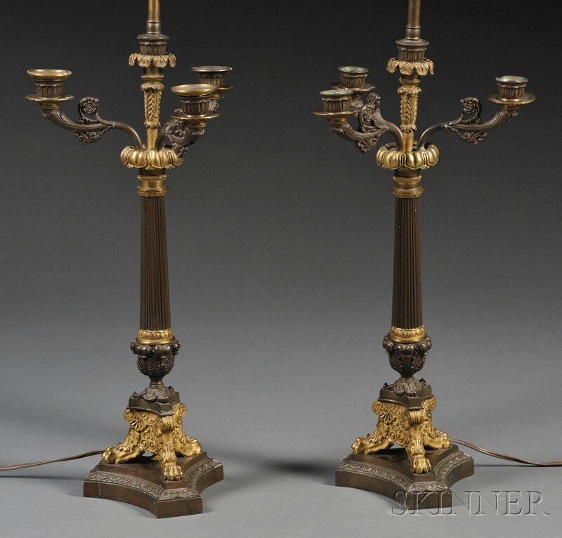 594: Pair of French Empire-style Parcel-gilt Bronze Fou