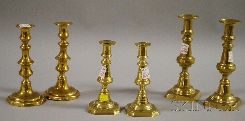 516: Three Pairs of Brass Candlesticks, ht. 7 to 8 7/8