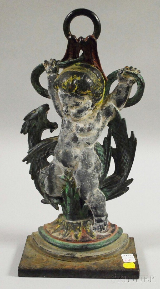 608: Painted Cast Iron Cherub and Sea Serpent Doorstop,
