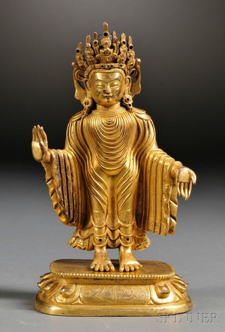 Gilt-bronze Buddha, China, wearing a crown, draped robe