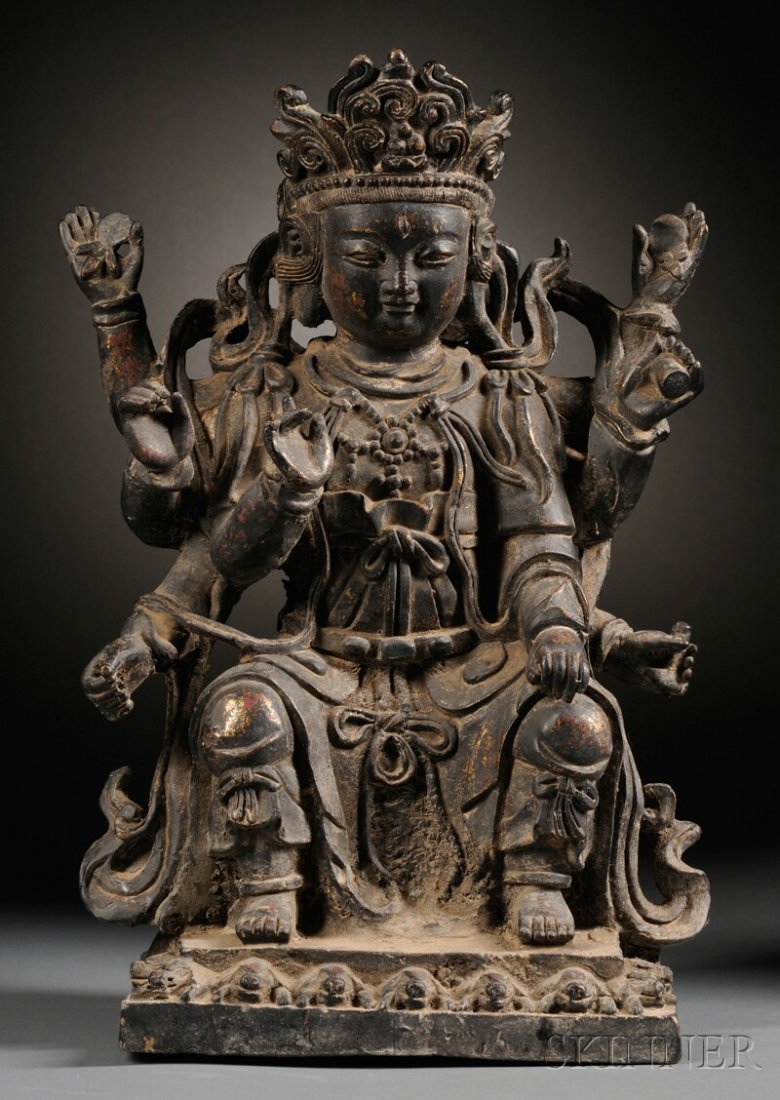 Bronze Figure, China, depicting a seated Kuan Yin with