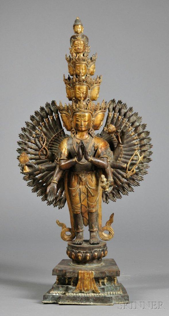 Gilt-bronze Thousand-arm Kuan Yin, China, with eleven h